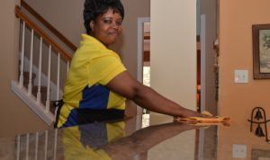 A photo of one of The Maids in Greensboro's team members cleaning a countertop